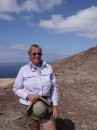 Sue,hiking atop one of the volcano ash cones at the island of Graciosa, just North East of Lanzarote.
