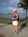 Causeway to Flamenco Marina, Sue with Panama City behind