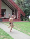 A Maori warrior performs the Haka out side the meeting house.