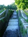 The old locks minus gates used as a spillway for the River Mohawk, by-passing the new locks.