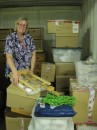 Sue, moving boxes around in our storage unit. Lots more to pack in but we are nicely organised now.