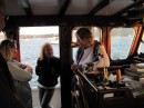 Lorraine, her mum (Bron) and Sue aboard Heimkehr: in the wheelhouse. How we long for a wheelhouse when it is cold and wet :-)