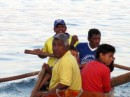 Some of the local fishermen in their dugout canoe.