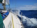 The afternoon following a night hove-to. Making fast progress towards Bermuda in big seas.