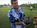 Andy is shown how to pick up the coconut crab with out loosing fingers!
