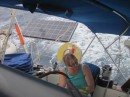 Sue helming on the wind, solar panel deployed under way