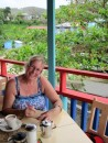 Sue catching up on her diary at Cocos, Bequia