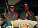 "John and Sue providing ""Sundowner Concert"" aboard Spruce anchored at Falmouth Harbour - Antigua. The audience were the crews of Aleria (Alex & Daria), Rapau (Keith & Welly), Moonlight (Anne with John playing clarinet)"