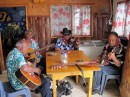 Local musicians serenading the customers in the cafe.