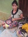 One of the beautiful baskets being woven.