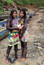 Two beautifully decorated Embera women come to welcome the group to the village.