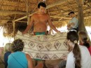 Ivan shows the group the traditional cloth worn by the Embera, it is made out of tree bark and is very scratchy.