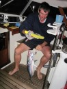 Andy tackling the juicy tuna caught at first light.