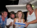 Opening the present carried from La Gomera by Pete and Kourtney (Aboard Norna) and sent by friends Andy & Lesley Scott (aboard Kodiak still in the Canaries)