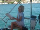 Valerie looking in the fish book to identify some of the fish she saw while snorkling