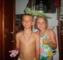 John and Sierra with their shark tooth necklaces and iguanas