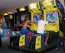 The kids discovered the Game Room-here are Savannah and John riding waverunners