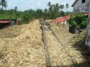 A railcar  transports the crushed sugar cane to the next building where the  crushed cane is used to heat the cane juice.JPG