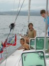 Laura, John and Luke on deck sailing to Coffin Island.