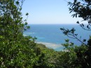 Cayos Cochinos - Glimpse of the reefs from a point along our jungle hike.