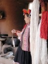 Local woman in The Sacred Valley spinning llama wool.