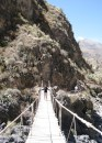 Heather crosses a sketchy bridge in Colca Canyon.