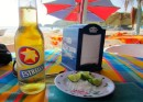 Enjoying a cold beer at a beach palapa