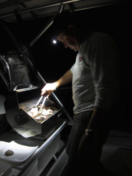 Dave barbecuing a great fish dinner while underway