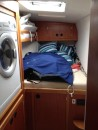 Reached by passing through the guest head, the forward guess stateroom offers a 3rd double bunk (small) and houses our washer / dryer.