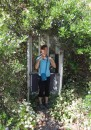 a very overgrown, but working, telephone booth at Whaletown, Cortes I