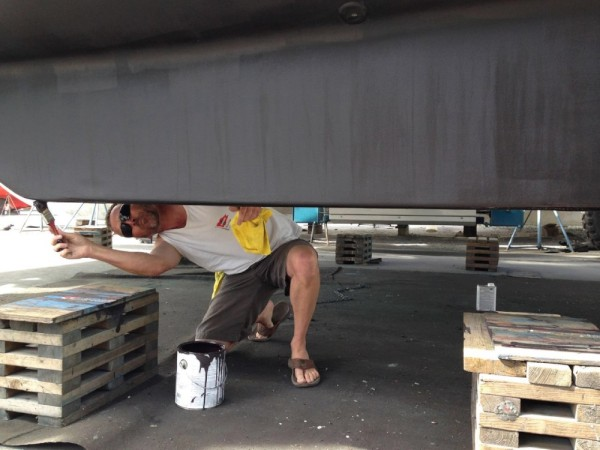 Trying to get a final coat of paint on that area on a boat that NEVER gets any paint