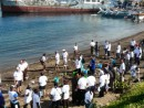 "Freddy Numberi plants mangrove trees along with the ""yachters"""