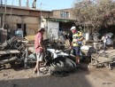 Selwyn and Alan trying to find something useful at the recycle market, Asmara.