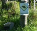 Takahe-crossing sign and rodent trap on Motutapu