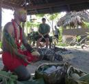 A traditional kitchen fale with a hot stone oven