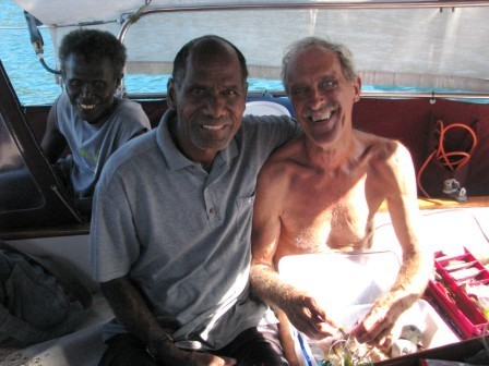 Jim and Willie picking out lines and lures. In the back in Kolopai, who had rowed Willie out to Asylum and kept a careful eye on the negotiations.