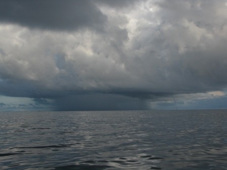 Serious squall spawning a waterspout