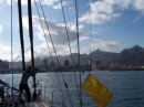 We are raising our yellow quarantine flag as we enter Mauritius - Shadow is taking photos from the bow of the boat