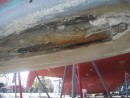 Bottom of the keel with the flap of glass removed down to the Iron ballast