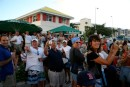 The crowd at the St Maarten Yacht Club watching Berkeley East and the mega yachts come through the bridge