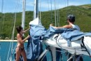 Linds and Bri do their chores  -  sail cover on before going ashore to play.