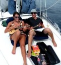 Linds & Bri practicing some ukelele tunes as we head for Waya Island  -  before the wind arrived!