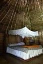 Inside the traditional bure  -  a very luxurious bed rather than mats on the floor.