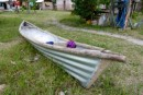 Neat fishing canoe made of corrugated roofing metal.