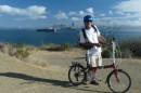 Norm with honkin big container ship and city in background.