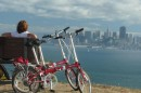 Beth enjoys a rest stop and great view of the city.  Our Dahon folding bikes are awesome for exploring places like Angel Island!
