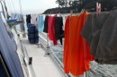 Drying out a lot of wet clothes at the end of the day.  How did so many clothes get so wet?  That