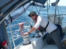 Kyle trims the head sails as we struggle to keep our speed down to 5 kts for dawn arrival.