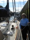 Jane tends lines to keep Voyageur in place after entering the lock.