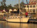 Jane stands on the foredeck in her winter finest in front of the River Dunes clubhouse.